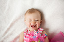 A laughing baby girl.