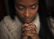 a woman with praying hands