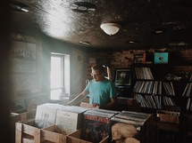 a man shopping in a record store