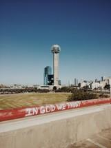 In God We trust written on a curb in Dallas