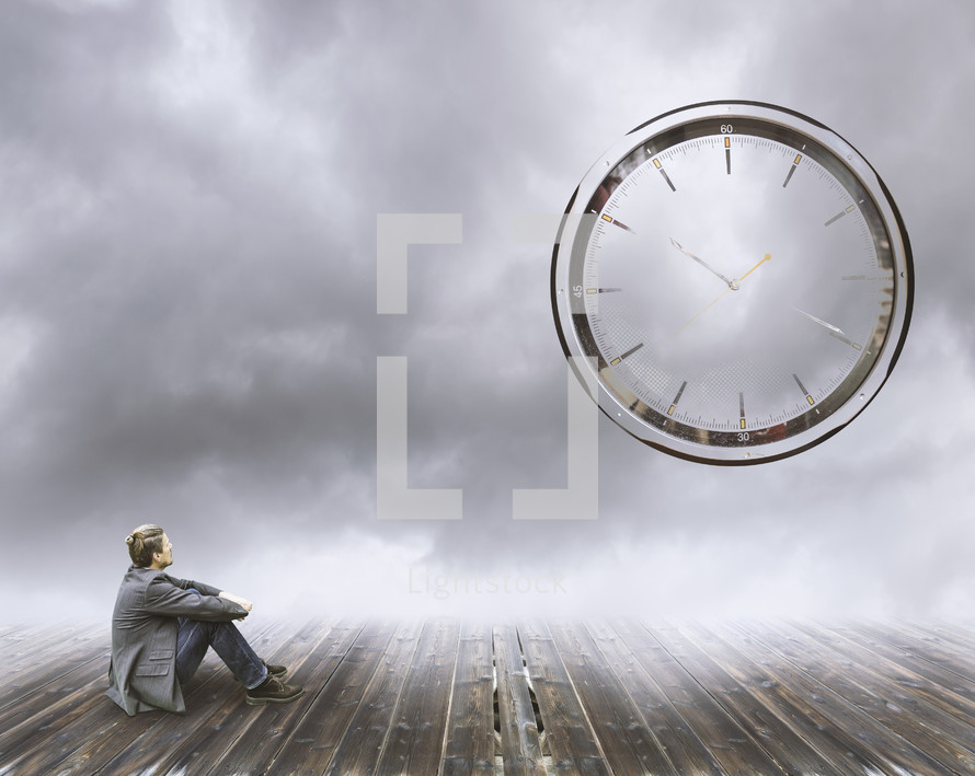 a man looking up at a clock in the sky