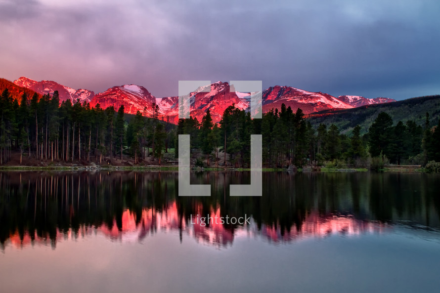 pink glow over mountain peaks