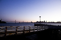 city dock looking at ocean San Francisco Bay bridge sunset