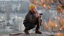 A man taking a photograph.