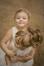 Sister siblings playing