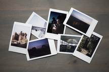 Group of Travel Polaroid Film Photographs Lay on Wooden Table