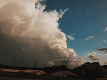 clouds over houses in a neighborhood