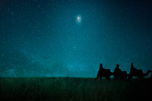 wisemen traveling on camels under the night sky