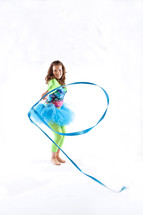 girl child performing rhythmic gymnastics