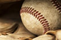 a baseball in a glove