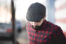man in a flat cap hat