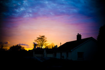 sunrise over a neighborhood