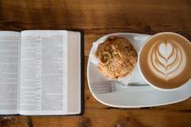 open Bible, cappuccino, plate, muffin, breakfast