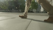 Low angle steady cam view of a man walking