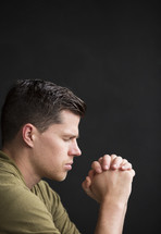 a side profile of a man in prayer