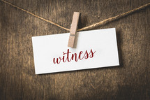 word witness on white card stock hanging from a clothespin on a clothesline