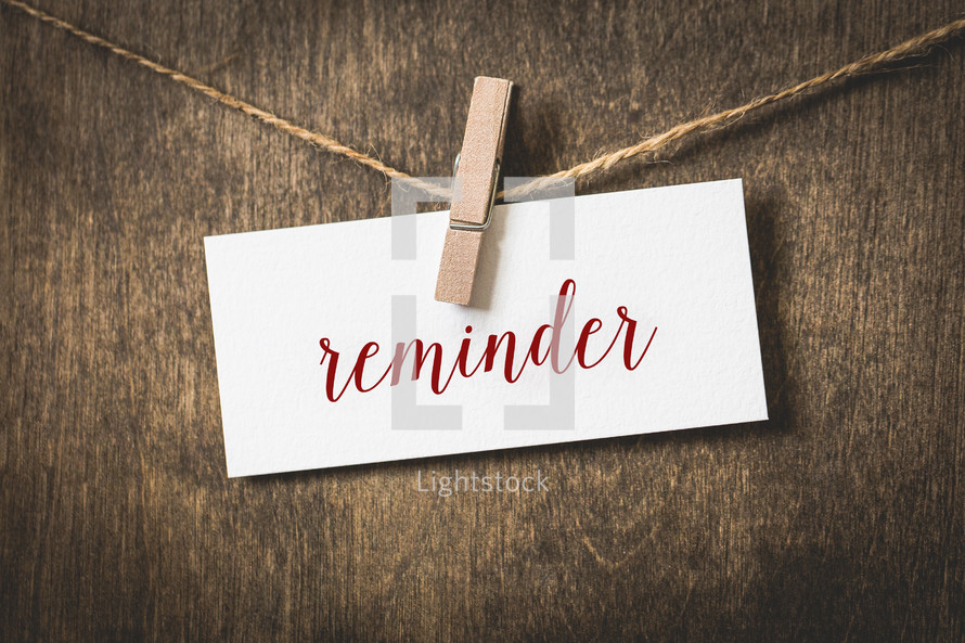 word reminder hanging on a clothesline