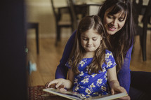 mother and daughter reading a children's Bible together
