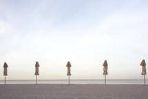 closed beach umbrellas on a beach