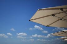 opened beach umbrellas