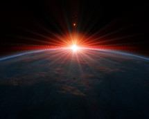 sun rising over planet Earth