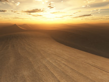 sunset over desert sand dunes