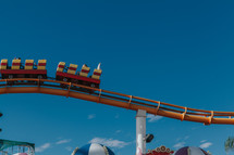 roller coaster against a blue sky