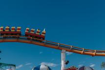 roller coaster against a blue sky