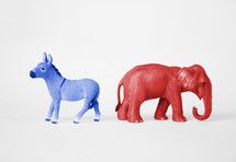 Blue Democratic donkey and red Republican elephant.