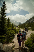 campers hiking on a nature trail in the mountains