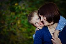 Son hugging mother.