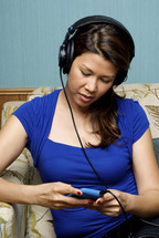 woman listening to her iPod with headphones