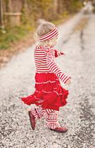 girl child running in the gravel