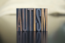 """""""Autism"""" block sign."""
