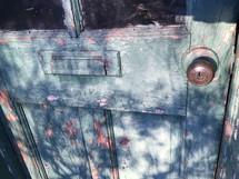 peeling paint on a wood door