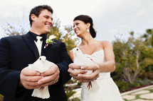 Bride and groom holding doves wedding day release love smiling laughing