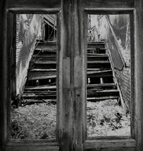 looking through door frames at broken stairs