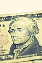 Alexander Hamilton on a ten dollar bill isolated on white