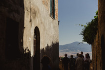 people gathered in front of a chapel in Italy