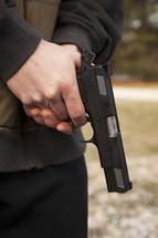 a man holding a hand gun