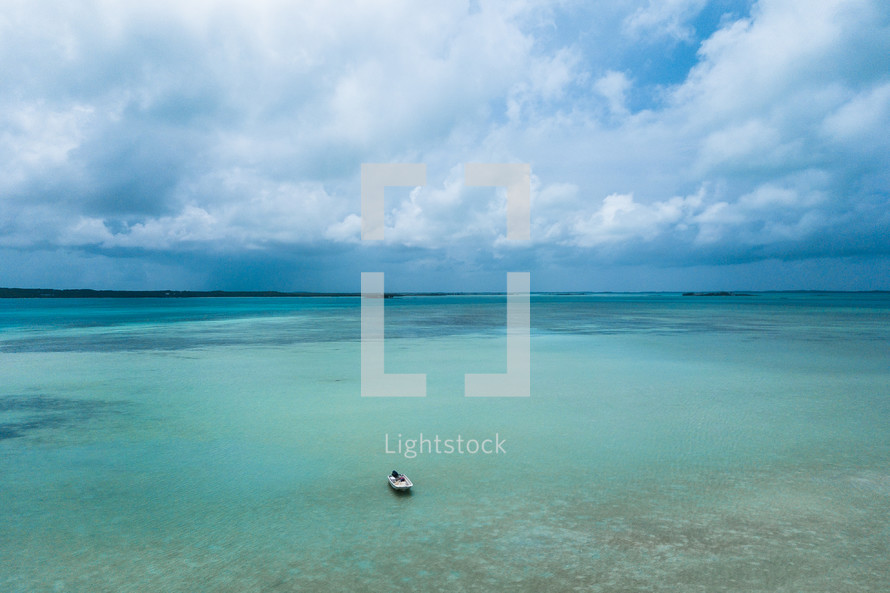 boat over reefs in the Bahamas