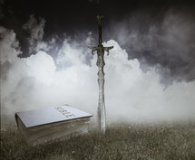sword and Bible on grass