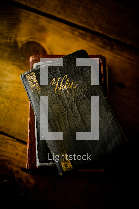 worn Bible on a wood table