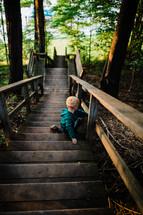 toddler boy on steps