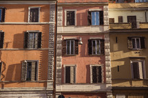 windows on the side of a building in Rome