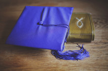 graduation cap and Bible