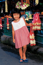 Girl child in a market in Thailand