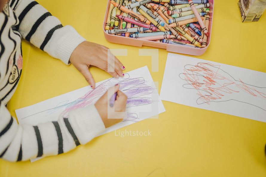 children coloring in a church nursery
