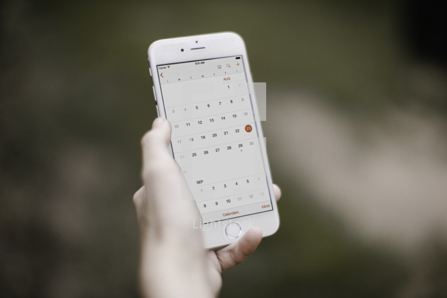 a person using a calendar app on their cellphone