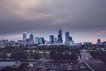 A large city skyline against a cloudy sky.
